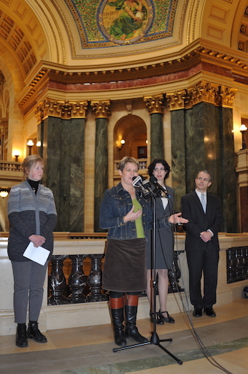Lisa Kivirist, co-author of Homemade for Sale, speaking at the Wisconsin State Capitol at the press conference for the lawsuit arguing that the State of Wisconsin's cookie and baked goods ban is unconstitutional. Photo: John D. Ivanko
